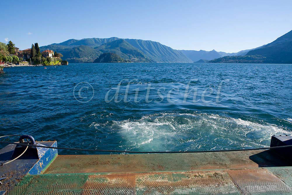 A car ferry creates a wake on Lake Como Italy. To purchase this image, please go to my stock agency click here.