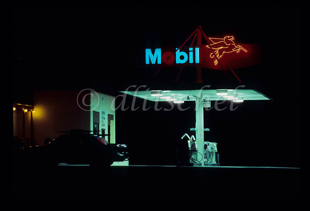 A n oldtime Mobil gas station in California at night.