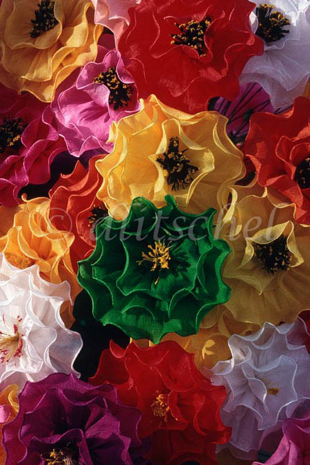 A display of colorful Mexican paper flowers at a street vendor's stall. To purchase this image, please go to my stock agency click here.