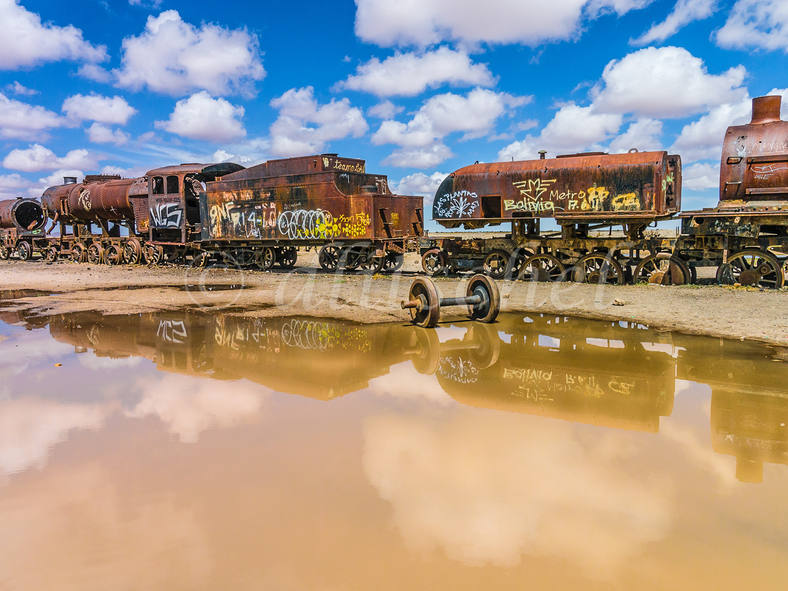 Bolivian train cemetery consisting of old steam locomotives and antique trains abandoned in Salar de Uyuni