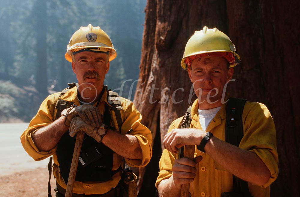 Two hotshot forest firefighters work a controlled burn in Sequoia National Park, California. To purchase this image, please go to my stock agency.
