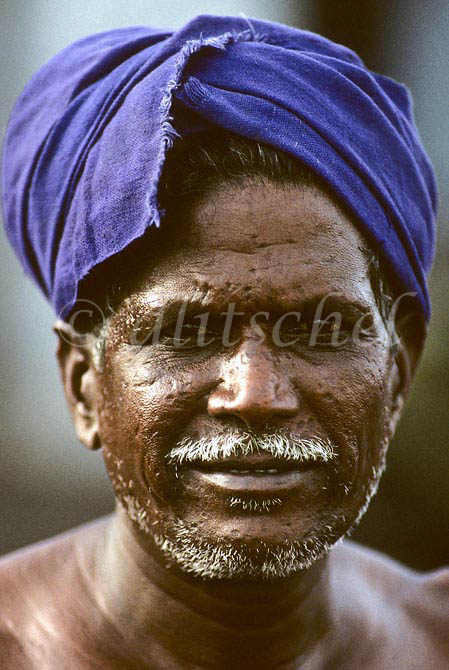 Indian dockworker with indigo colored turban in the southern indian city of Chennai, formerly known as Madras. To purchase this image, please go to my stock agency click here.
