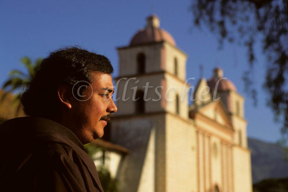 A padre pauses in early morning light outside of the Santa Barbara Mission, known as the {quote}queen of the missions{quote} in California. To purchase this image, please go to my stock agency.