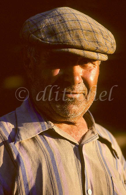 Middle aged Siberian man wearing wool hat in late evening light in the Krasnoyarsk Krai region of Siberia. To purchase this image, please go to my stock agency click here.