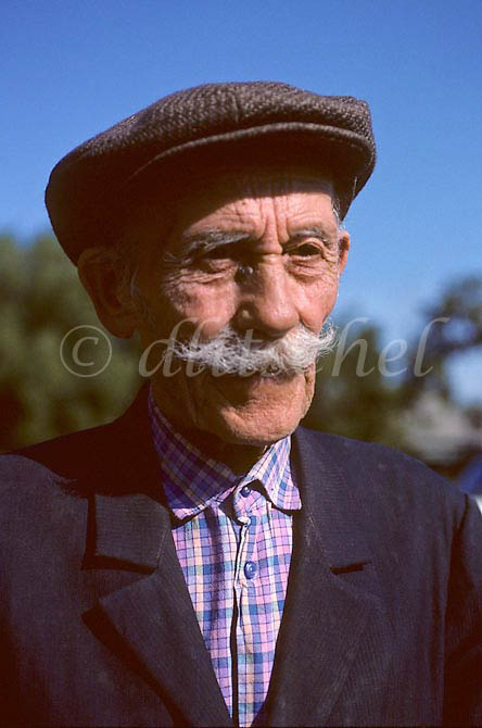 A senior citizen in a wool hat and prominent mustache in a small village in the Krasnoyarsk Krai region of Siberia. To purchase this image, please go to my stock agency click here.