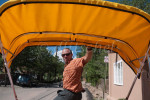 Tracy Kurtenbach drives his petty cab through the streets of Santa Fe, New Mexico