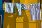 Laundry Drying in the colorful fishing village of Burano, Italy, located on Burano Island, a short commute by Vaporetto (water taxi) from Venice, Italy. To purchase this image, please go to my stock agency.
