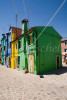 A street scene of the typical residential architecture of Burano Island, off the coast of Venice, Italy. To purchase this image, please go to my stock agency click here.
