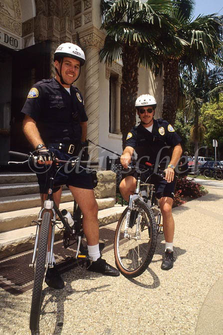 Two bicycle Santa Barbara, California policemen patrol the streets of Santa Barbara. To purchase this image, please go to my stock agency.