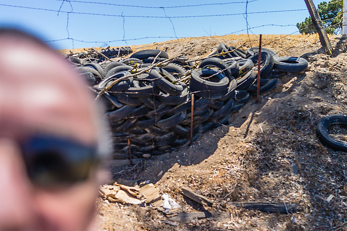 Selfie with discarded tires, Shandon, California.