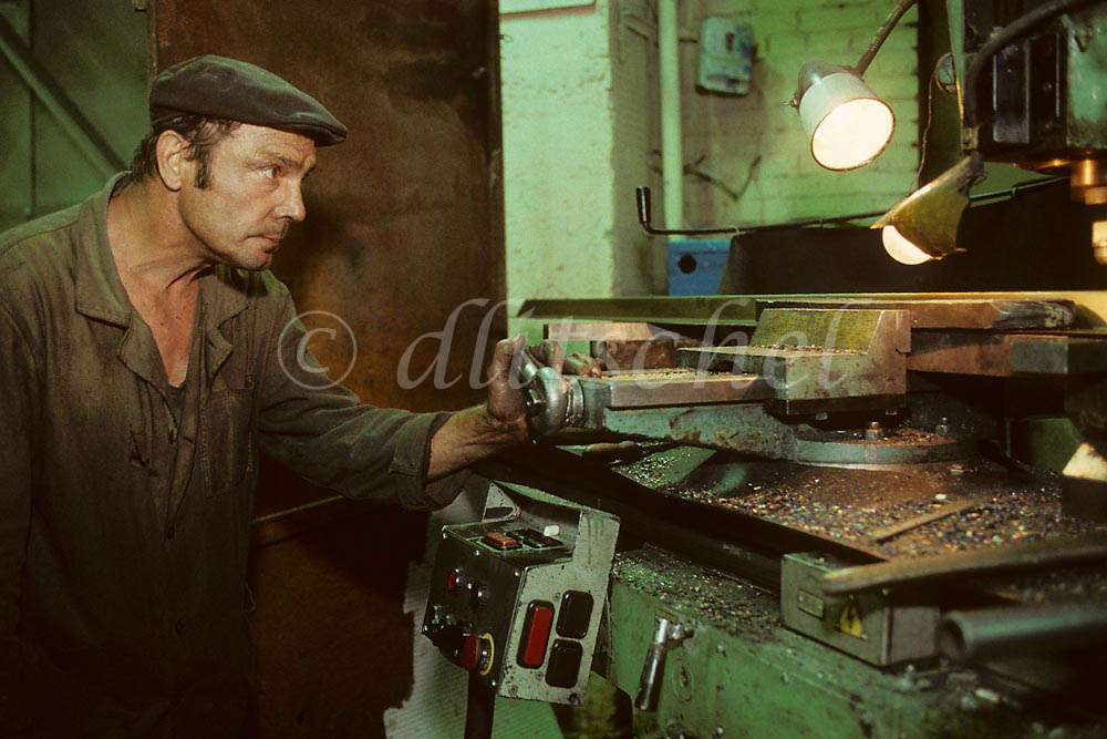 Siberian machinist at work in the city of Krasnoyarsk at the convergence of the Trans Siberian Railway and the Yenisei River.  To purchase this image, please go to my stock agency click here.