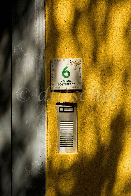 Detail of the front of an Italian home with house number and intercom in the Lake Como town of Tremezzo Italy. To purchase this image, please go to my stock agency click here.