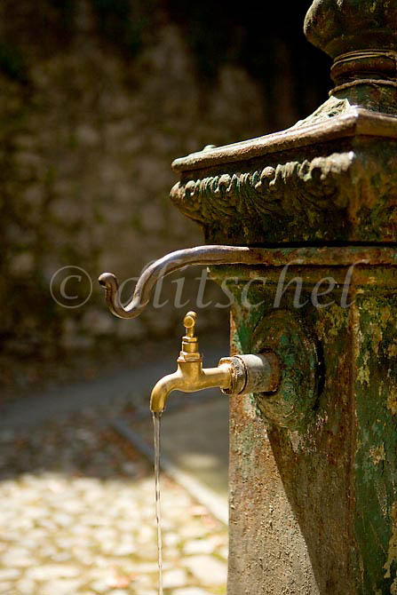 Community water tap in Tremezzo Italy, a community on Lake Como. To purchase this image, please go to my stock agency click here.