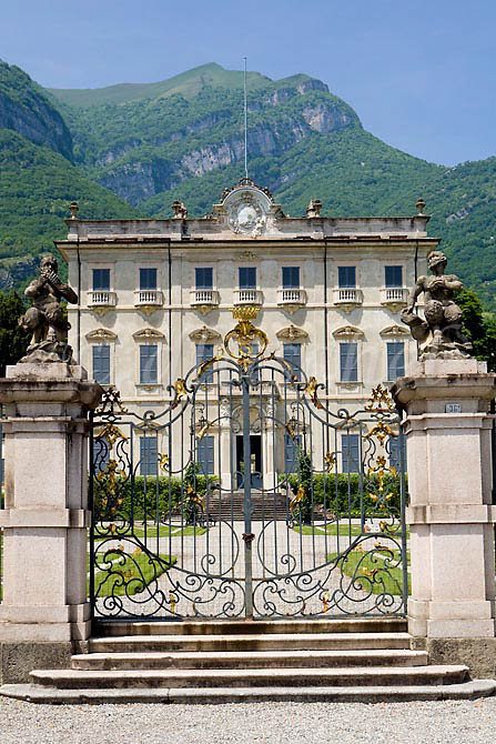 A view of the front of an Italian palace from outside the front gates in Tremezzo Italy on Lake Como. To purchase this image, please go to my stock agency click here.