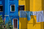 Drying laundry in the colorful fishing village of Burano, Italy, located on Burano Island, a short commute by Vaporetto (water taxi) from Venice, Italy.To purchase this image, please go to my stock agency click here.