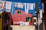 Laundry Drying in the colorful fishing village of Burano, Italy, located on Burano Island, a short commute by Vaporetto (water taxi) from Venice, Italy. To purchase this image, please go to my stock agency click here.