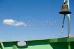 A view of a boat bow, bell and cloud in a clear blue sky on the Vaporetto (water taxi) from Venice to Burano Island, Italy. To purchase this image, please go to my stock agency click here.