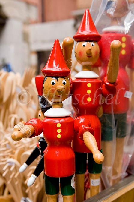 Two wooden pinocchio toys for sale in a Venice, Italy store. To purchase this image, please go to my stock agency click here.