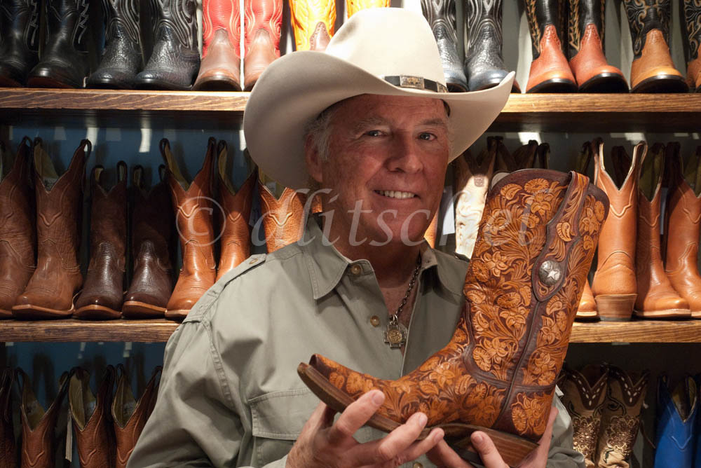 Roy Flynn owner of Boots & Boogie, a cowboy boot store in  downtown Santa Fe, New Mexico, USA, displays one of his better boots for sale.