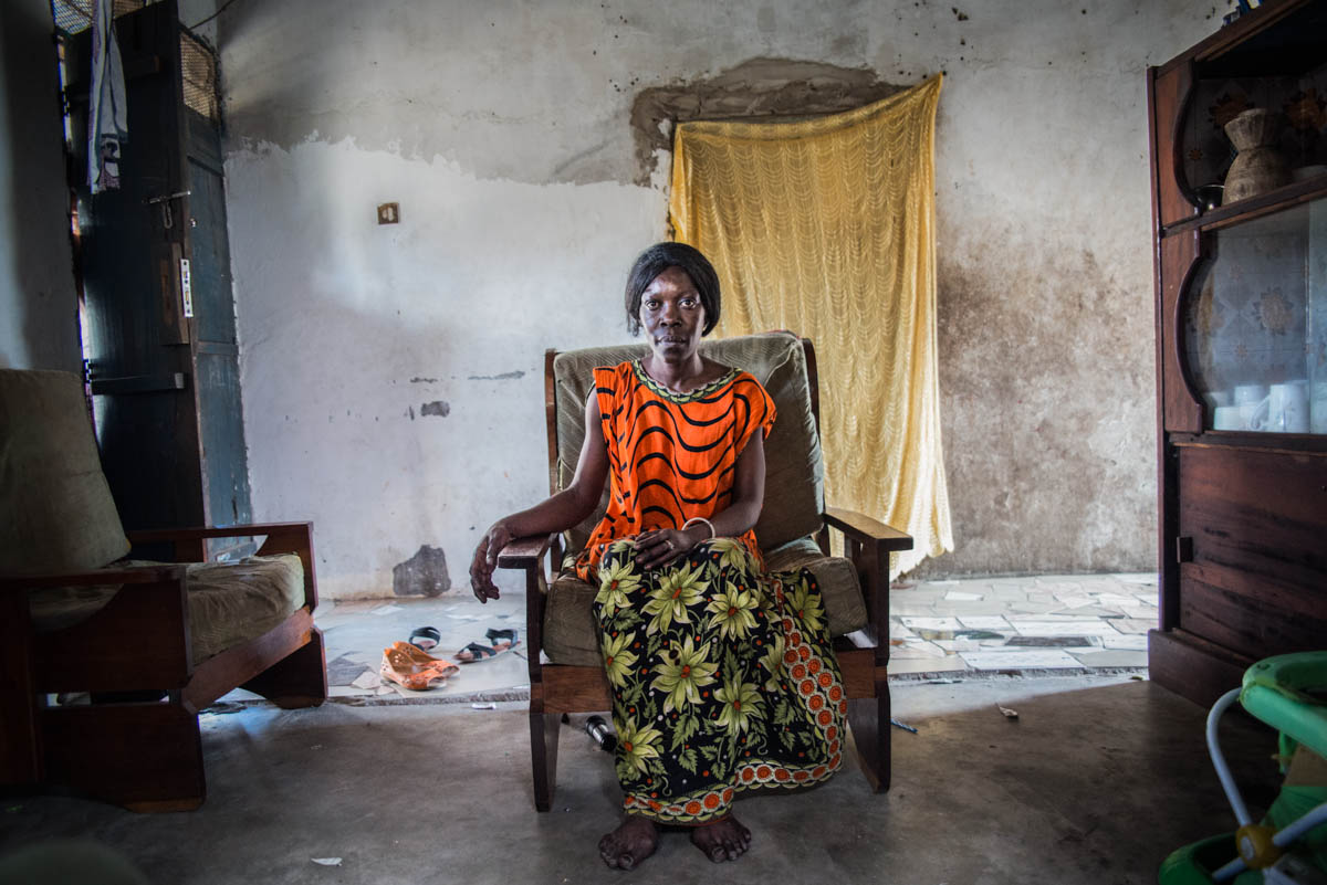 A 46 year old sex worker addicted to smoking 'Kokteli's' a mixture of cannabis, tobacco and heroin sits in her home in Dar Es Salaam, Tanzania.