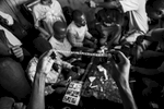 In a drug den in Dar es Salaam, plastic pockets of heroin fresh from South Asia are held up and counted by a dealer.