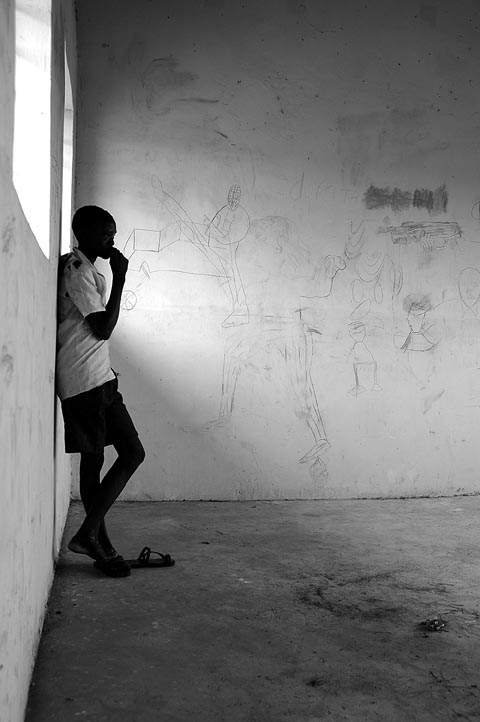 14 year old Jakob Odigo stands in his deserted classroom. Jakob enjoys playing football but unlike normal teenagers he lives in the fear of being abducted or killed. Jakob has seen his friends, both girls and boys being abducted. {quote}When I see a man in uniform, I think will he be friendly and let me pass, or will he finish me off? Shall I run? I have to think fast, I am very scared. My parents have warned me to be alert all the time. If I sit under a tree alone, I can't relax, I feel afraid.{quote}