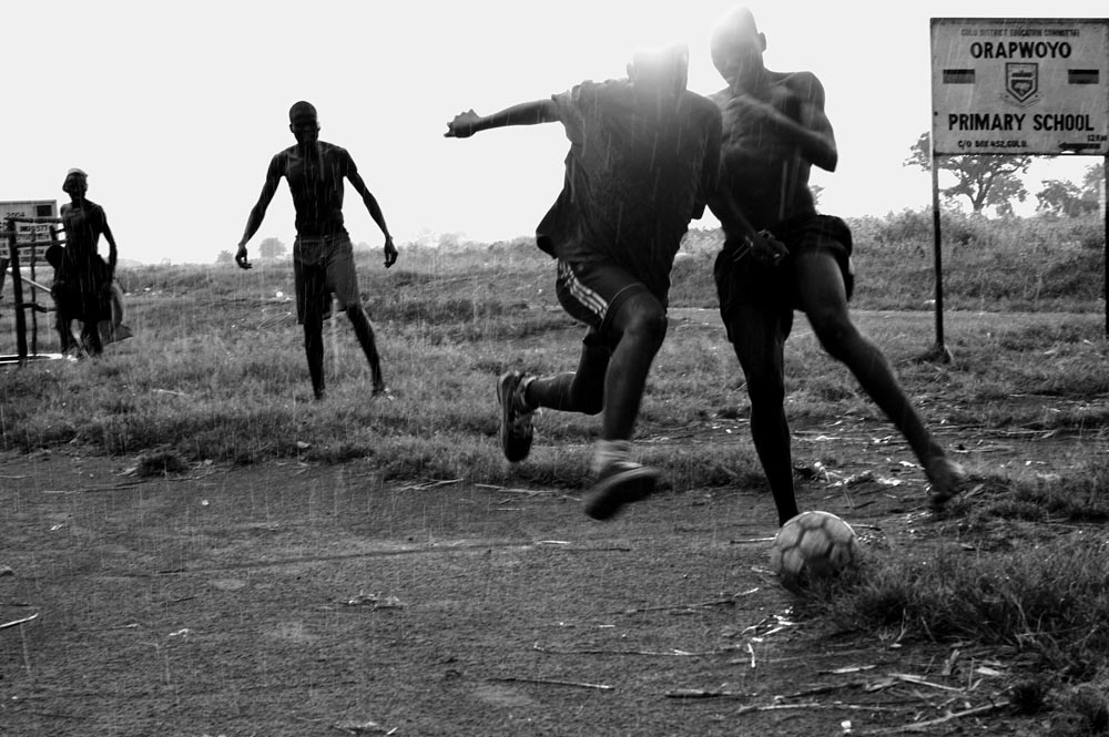 Ex - LRA rebels play football.