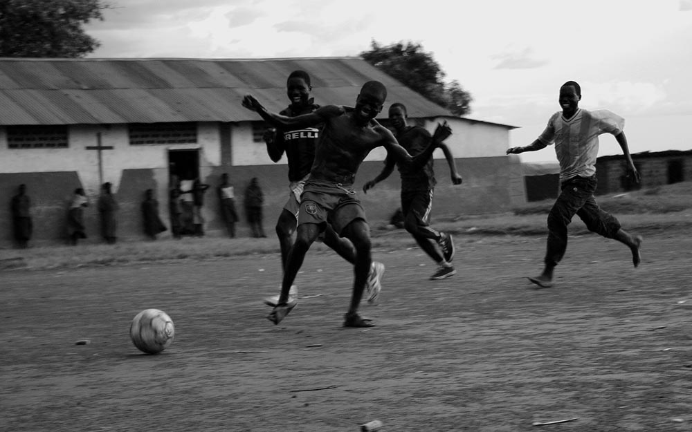 Ex- LRA rebels play football.