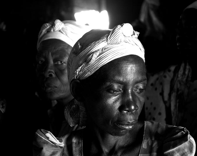 Women attend a Sunday church service. To many- prayer is all they have.