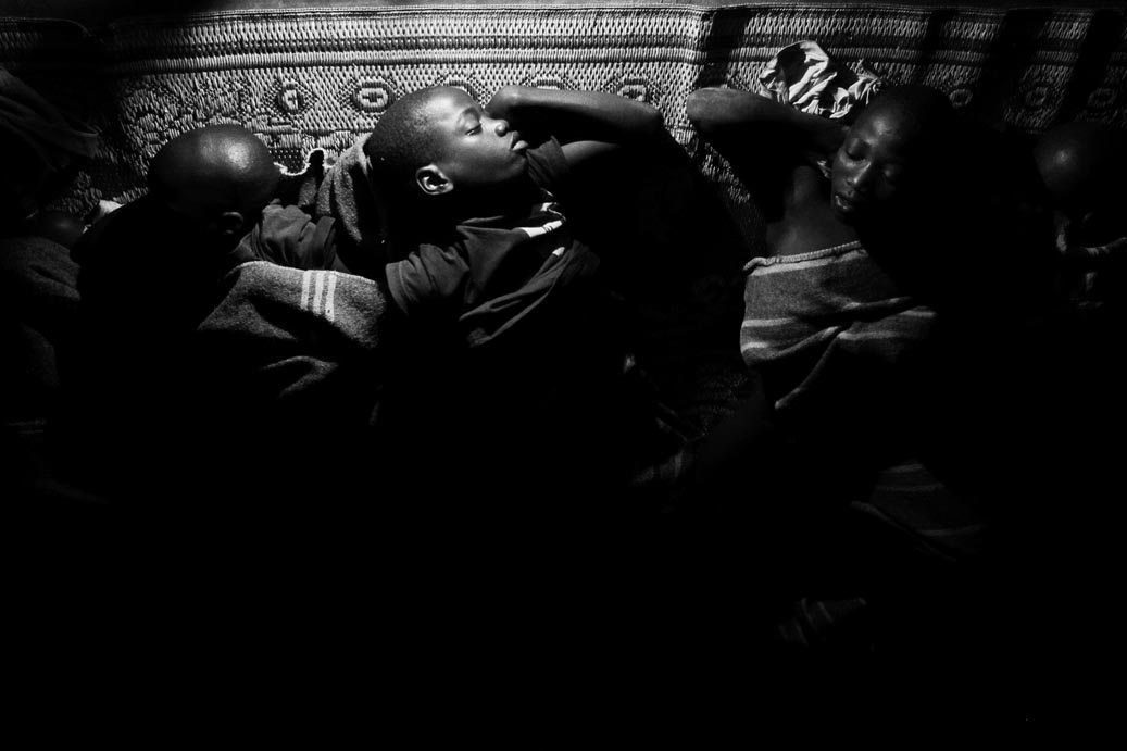 Child night commuters rest in the {quote}safety{quote} of one of the many sleeping centres in Gulu.  By late afternoon, thousands of children  would leave school to walk extreme distances to the {quote}safety{quote} of the charity run sleeping centres in Gulu town. Abduction at night by the LRA rebels was rife.