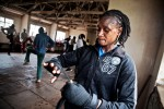 Sarah Achieng Ndisi re wraps her wrists during sparring at Kariobangi Community Centre. Sarah is a Boxgirls graduate and coach. She is currently the best professional female boxer in East Africa under the feather weight category.