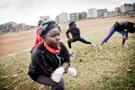 Boxgirls warm up in a field outside the community centre in Kariobangi slum.