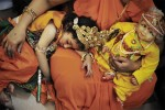 A child sleeps on his mother at Jalaram Temple, Nairobi.