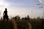 Achet IDP camp -Ex LRA rebels play football.