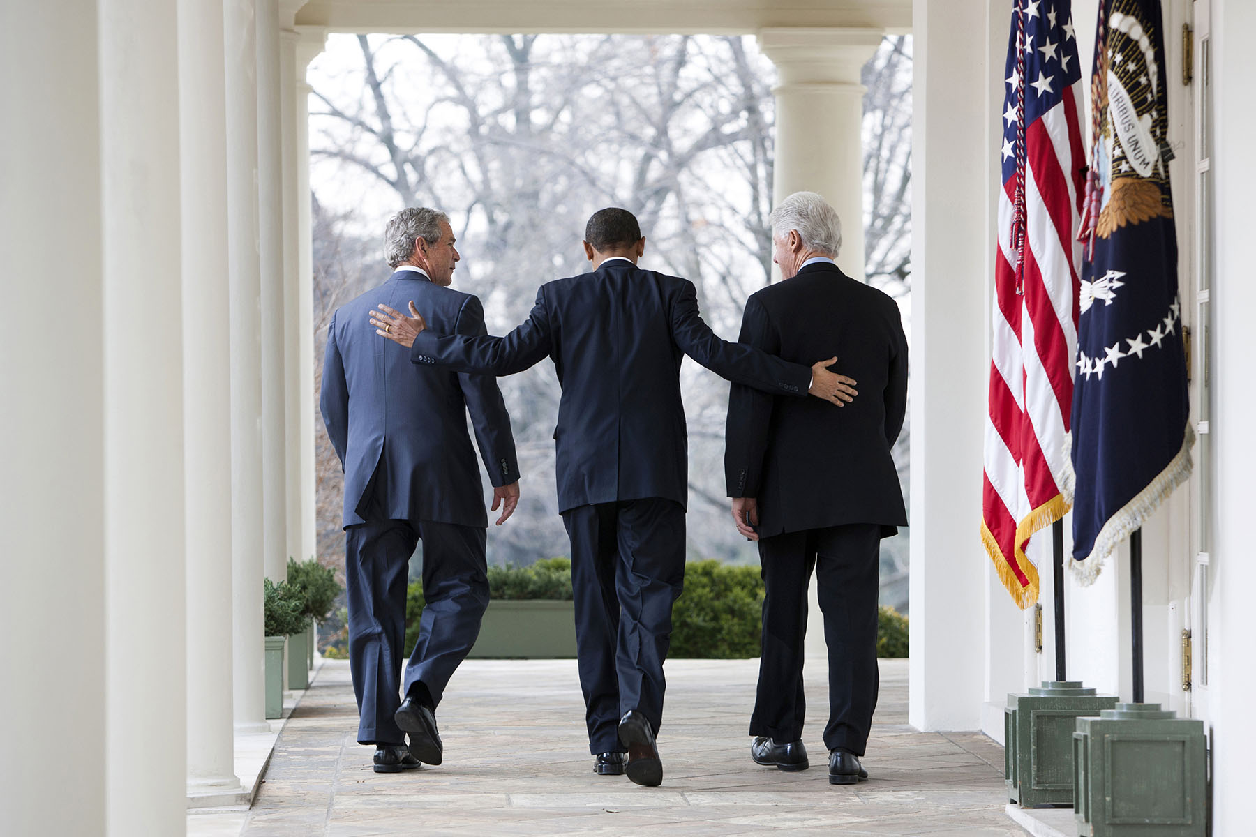 President Barack Obama speaks as former Presidents Bill Clinton and George W. Bush, right, listen in the Rose Garden at the White House in Washington. Obama asked the former presidents to help with U.S. relief efforts in Haiti after the earthquake.