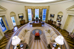 An intererior view of the Oval Office empty of people during the George W Bush Administration.    The Oval Office is the official office of the President of the United States. Located in the West Wing of the White House, the elliptical-shaped office features three large south-facing windows behind the president's desk and a fireplace at the north end of the room.Photo by Brooks Kraft/Corbis