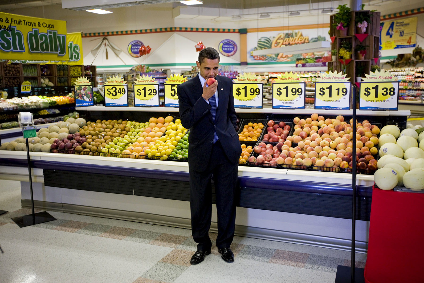 President Barack Obama picks out a peach after a town hall meeting on health care in a Kroger supermarket in Bristol, Va. Photo by Brooks Kraft/Corbis
