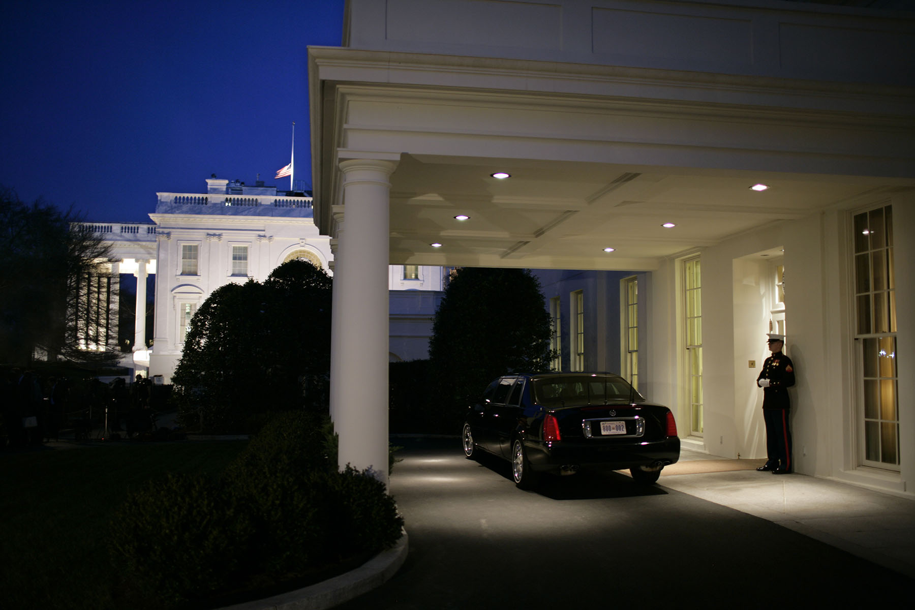 A United States Marine stands guard at the diplomatic entrance of the West Wing, near German Chancellor Angela Merkel's limousine.    Merkel was meeting with President Bush in the Oval Office at the White House in Washington Thursday, Jan. 4, 2007.Photo by Brooks Kraft/Corbis