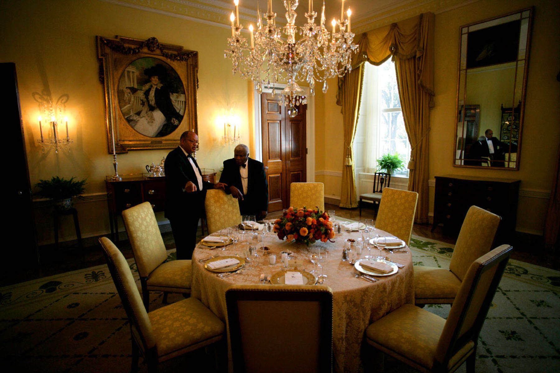 Members of the White House Maitre'De staff go over final arrangements for a dinner in the Old Family Dining Room at the White House.  President George W Bush is hosting a working dinner with Pakistani President Pervez Musharraf and Afghan President Hamid Karzai after a trilateral meeting in the Oval Office.    Also attending the dinner are Vice President Dick Cheney, Secretary of State Condoleezza Rice, National Security Advisor Stephen Hadley and the  ambassadors to Pakistan and Afganistan.Photo by Brooks Kraft/Corbis