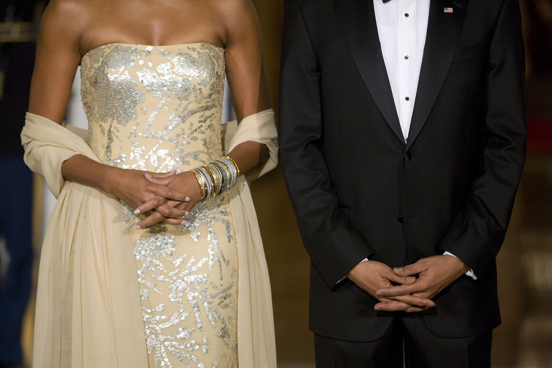 U.S. President Barack Obama and first lady Michelle Obama await the arrival of India's Prime Minister Manmohan Singh and his wife Gursharan Kaur for a state dinner on the North Portico of the White House.