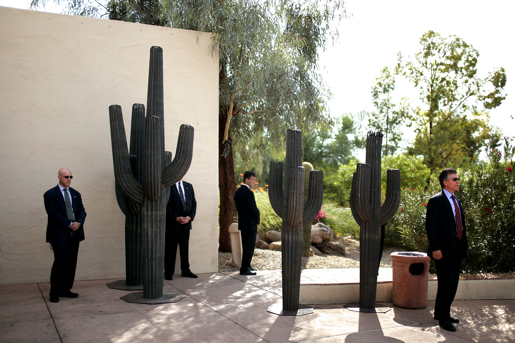 Secret Service agents watch as President George W. Bush attends a signing ceremony for the 2007 Department of Homeland Security Appropriations Act, in Scottsdale, Arizona, October 4, 2006.Photo by Brooks Kraft/Corbis