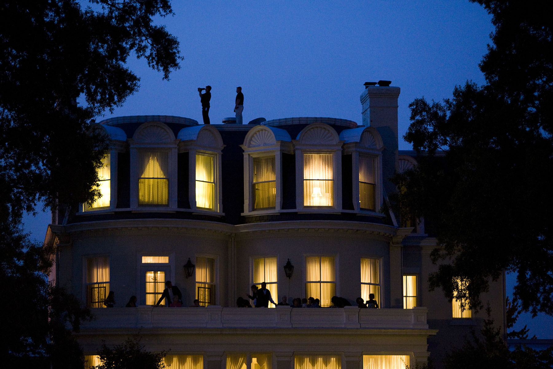 Secret Service watch as Marines perform during the evening parade attended by President Barack Obama at the Marine Corps Barracks in Washington.Photo by Brooks Kraft/Corbis