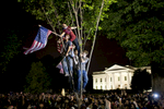Crowds celebrate on Pennsylvania Avenue in front of the White House in Washington, after President Barack Obama announced that Al-Qaida's leader Osama bin Laden had been killed.