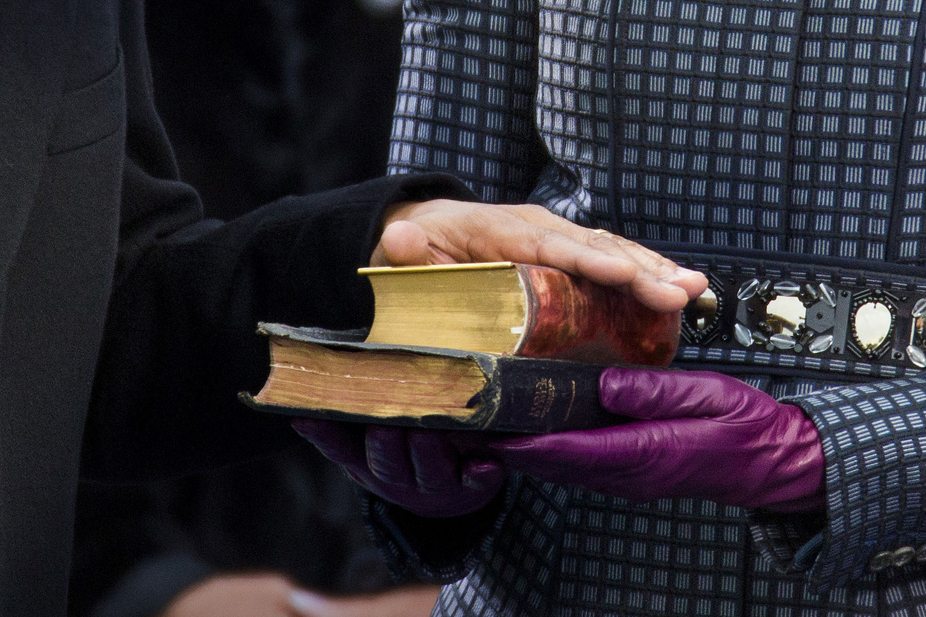 U.S. President Barack Obama places his hand on two bibles as held by first lady Michelle Obama as his recites the oath of office during swearing-in ceremonies on the West front of the U.S Capitol in Washington.  The first is the Bible used by former President Abraham Lincoln,  when he took the oath of office in 1861.  The second Bible is the so-called {quote}traveling Bible{quote} used by slain civil rights leader Martin Luther King, Jr.