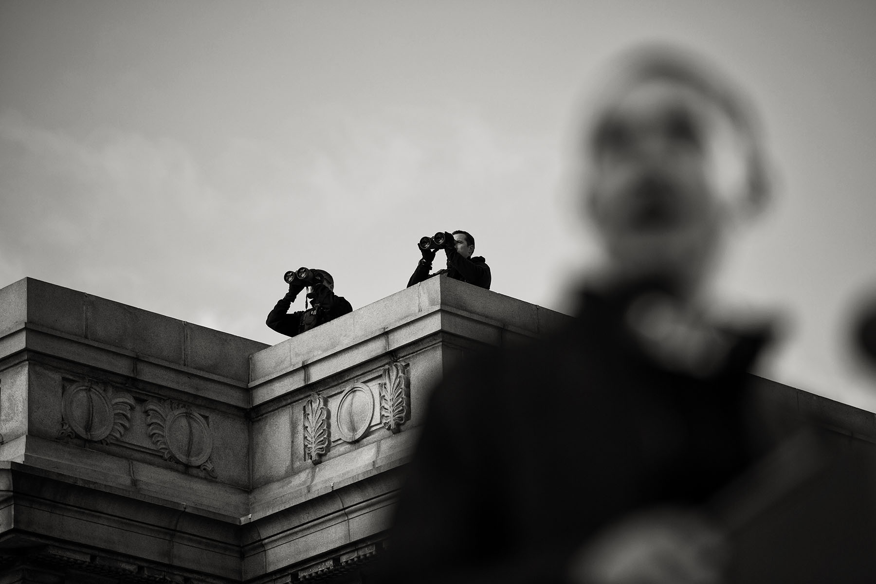 Secret Service snipers watch on a rooftop as President Barack Obama speaks at a campaign rally in Concord, NH.