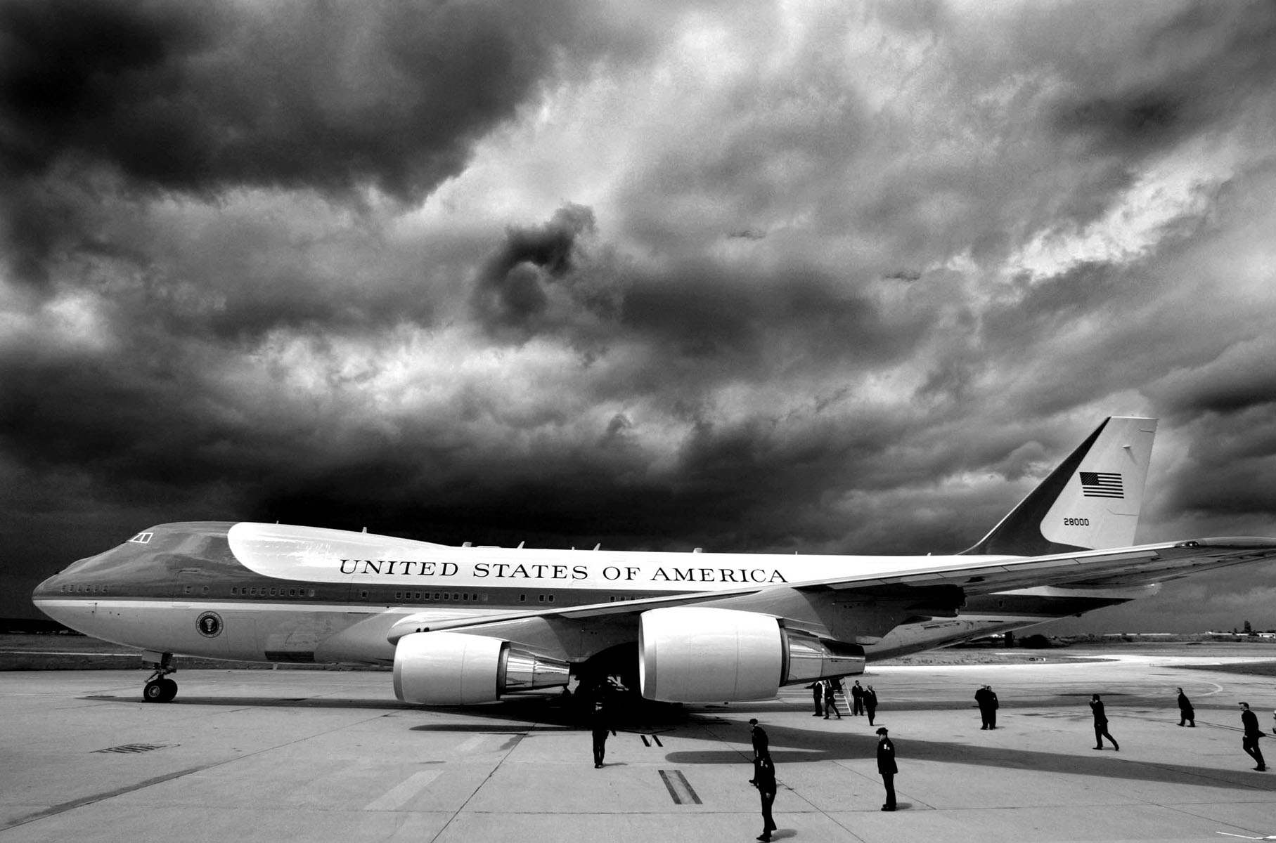 Storm clouds loom overhead as Air Force One and U.S. President George W. Bush arrive in Paris.