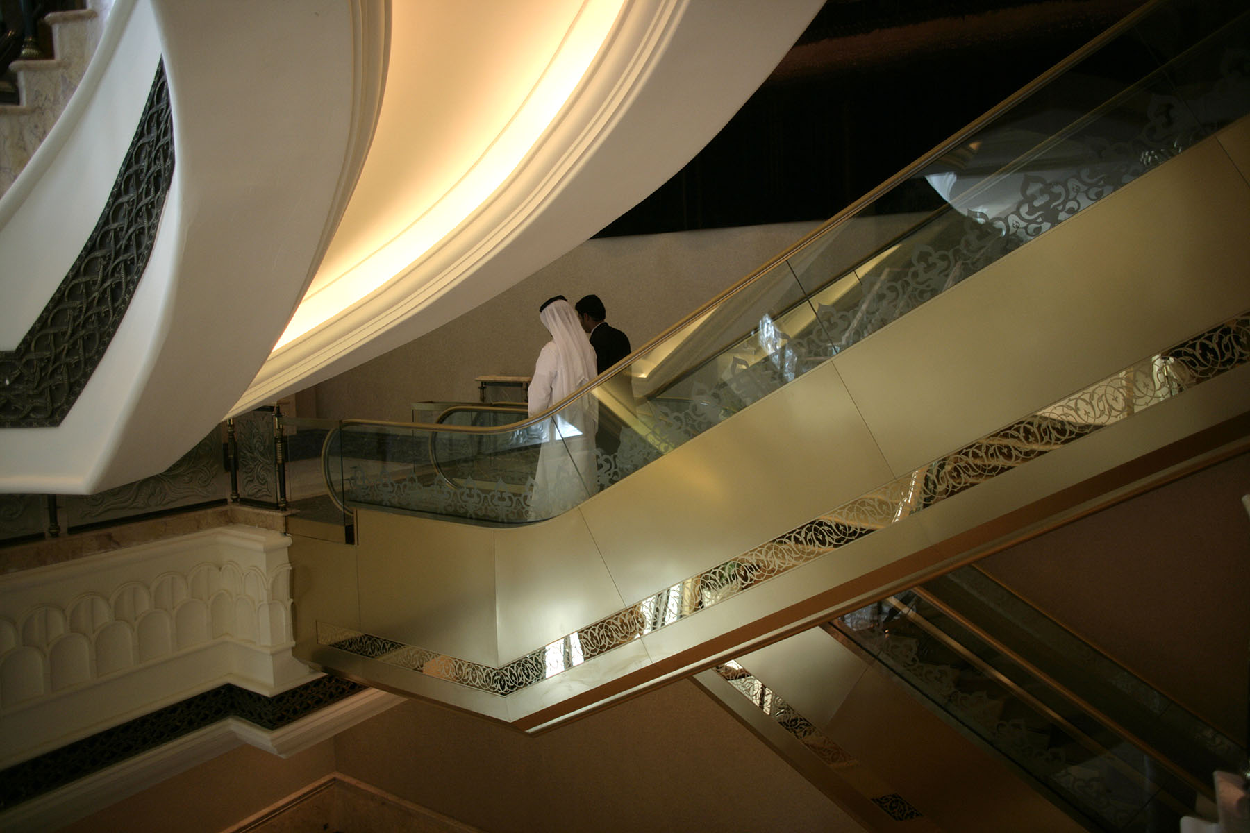 Businessmen at The Imperial Palace Hotel in Abu  Dhabi, United Arab Emirates.  The luxury 350 room hotel and conference center complex was built by UAE government at a cost of 3.5 billion dollars.Photo by Brooks Kraft/Corbis