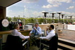 Business men have a conversation at a roof top restaurant in Sao Paulo, Brazil.Photo by Brooks Kraft/Corbis