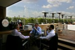 Business men have a conversation at a roof top restaurant in Sao Paulo, Brazil.