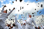 Members of the United States Naval Academy Class of 2005 throw their hats after commencement ceremonies in Annapolis May 27, 2005.  President Bush gave handed out diplomas to 976 graduates this year. Photo by Brooks Kraft/Corbis